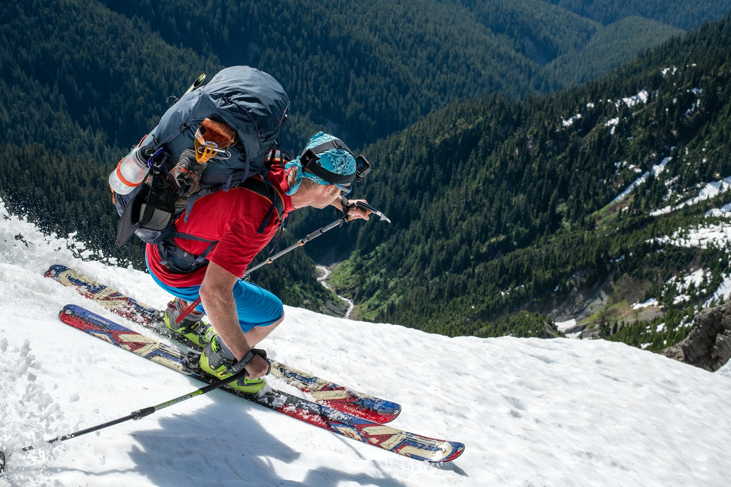 A backcountry skier makes turns down a glacier in Washington's Olympic Peninsula